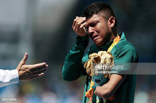 Gold medalist Petrucio Ferreira dos Santos of Brazil celebrate on the podium at the medal ceremony for the Menâs 100 meter â T47 Final during day 4...