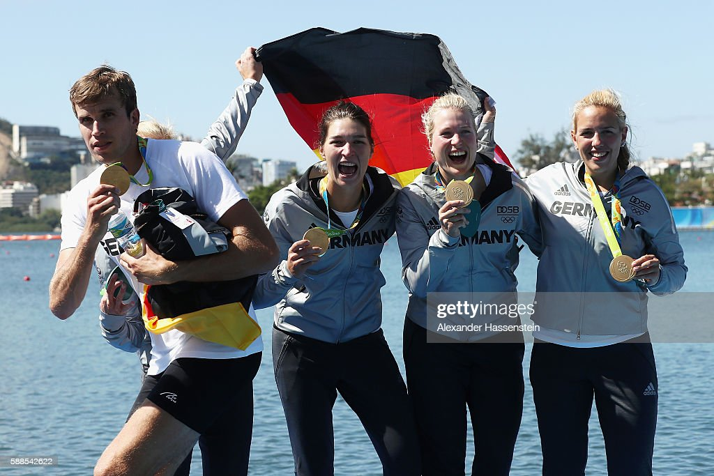 Gold medalist Philipp Wende of Germany jokes around following the medal ceremony for the Women's Quadruple Sculls Final on Day 6 of the Rio 2016 Olympic Games at the Lagoa Stadium on August 11, 2016 in Rio de Janeiro, Brazil.