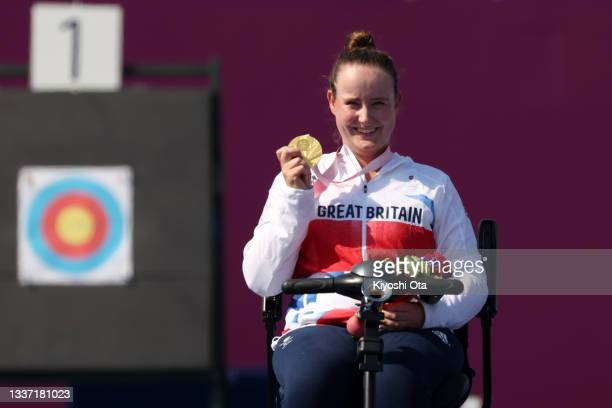 Gold medalist Phoebe Paterson Pine of Team Great Britain poses on the podium at the medal ceremony for the Women's Individual Compound - Open on day...