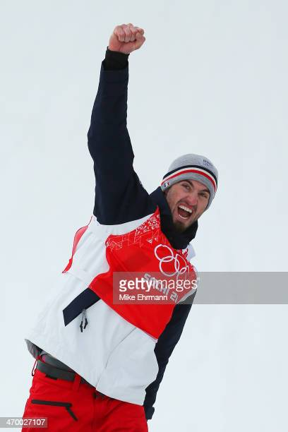 Gold medalist Pierre Vaultier of France celebrates during the flower ceremony for the Men's Snowboard Cross Final on day eleven of the 2014 Winter...