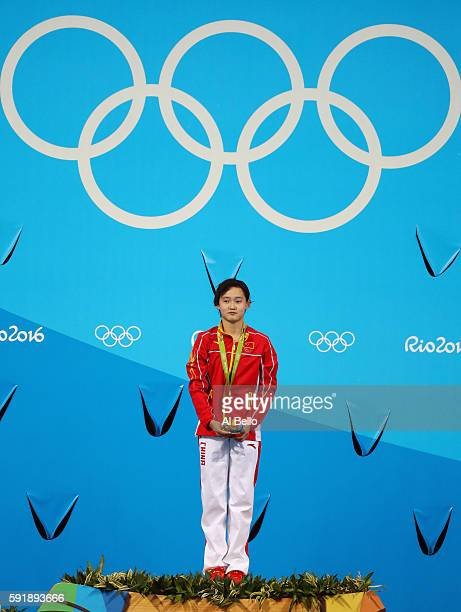 Gold medalist Qian Ren of China stands on the podium during the medal ceremony for the Women's 10m Platform final diving contest at the Maria Lenk...