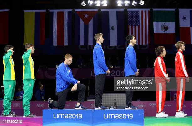 Gold medalist Race Imboden of United States takes a knee during the National Anthem Ceremony in the podium of Fencing Men's Foil Team Gold Medal...