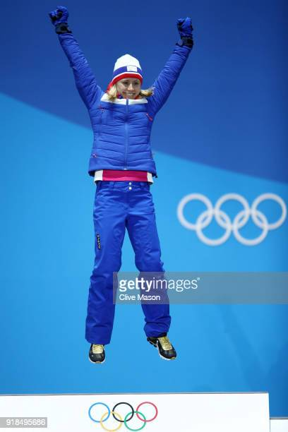 Gold medalist Ragnhild Haga of Norway celebrates during the medal ceremony for CrossCountry Skiing Ladies' 10km Free on day six of the PyeongChang...