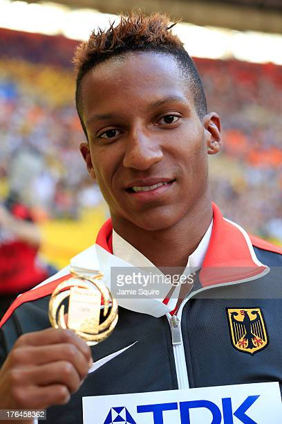 Gold medalist Raphael Holzdeppe of Germany poses on the podium during the medal ceremony for the Men's Pole Vault during Day Four of the 14th IAAF...