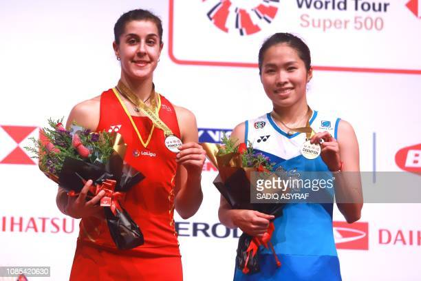 Gold medalist Ratchanok Intanon of Thailand poses with runner up Carolina Marin of Spain at the podium after the women's singles final at the...