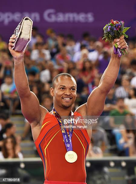 Gold medalist Rayderley Miguel Zapata Santana of Spain celebrates on the podium during the medal ceremony for the Men's Floor Exercise final on day...