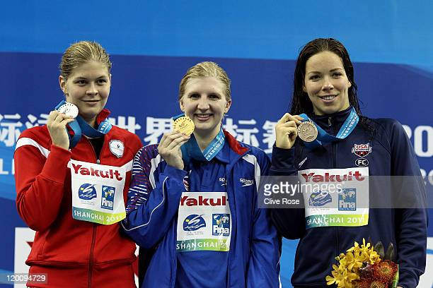 Gold medalist Rebecca Adlington of Great Britain poses with silver medalist Lotte Friis of Denmark and bronze medalist Kate Ziegler of the United...