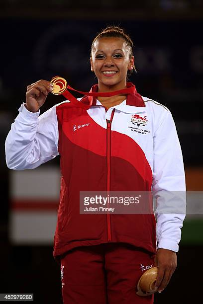 Gold medalist Rebecca Downie of England poses during the medal ceremony for the Women's Uneven Bars Final at SSE Hydro during day eight of the...