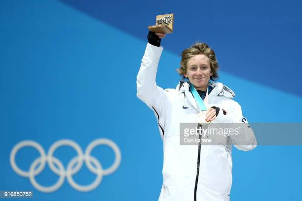 Gold medalist Redmond Gerard of the United States celebrates on the podium during the Medal Ceremony for the Men's Snowboard Slopestyle on day two of...