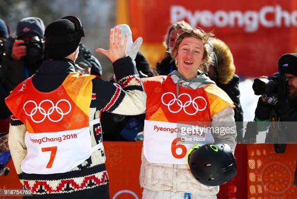 Gold medalist Redmond Gerard of the United States celebrates with silver medalist Max Parrot of Canada during the Snowboard Men's Slopestyle Final on...