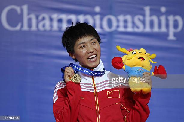 Gold medalist Ren Cancan of China offers a military salute during the award ceremony of the Women's 51kg Final during the AIBA Women's World Boxing...