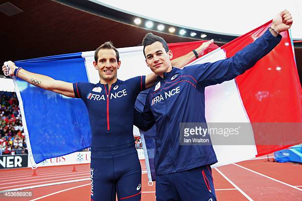 Gold medalist Renaud Lavillenie of France and joint bronze medalist Kevin Menaldo of France pose with the French national flag after the Men's Pole...