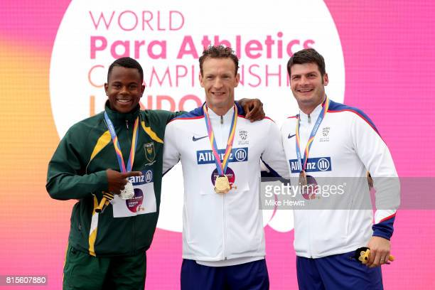 Gold medalist Richard Whitehead of Great Britain Silver medalist Ntando Mahlangu of South Africa and Bronze medalist David Henson of Great Britain...