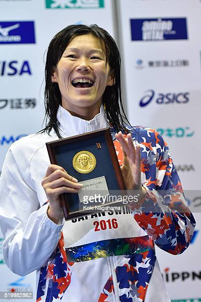 Gold medalist Rie Kaneto celebrates after winning the Women's 200m Breaststroke final during the Japan Swim 2016 at Tokyo Tatsumi International...