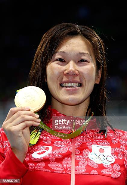 Gold medalist Rie Kaneto of Japan celebrates on the podium during the medal ceremony for the Women's 200m Breaststroke Final on Day 6 of the Rio 2016...