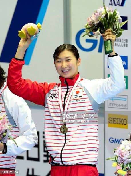 Gold medalist Rikako Ikee celebrates on the podium at the medal ceremony for the Women's 100m Butterfly on day four of the Swimming Japan Open at...
