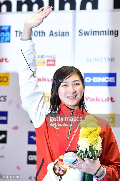 Gold medalist Rikako Ikee of Japan waves for her teammates on the podium after Women's 50m Freestyle final during the 10th Asian Swimming...