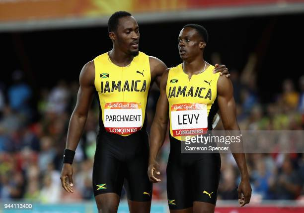 Gold medalist Ronald Levy of Jamaica and silver medalist Hansle Parchment of Jamaica celebrate after the Men's 110 hurdles final during the Athletics...