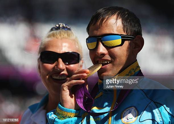 Gold medalist Ruslan Katyshev of Ukraine poses on the podium during the medal ceremony for the Men's Long Jump - F11 Final on day 6 of the London...