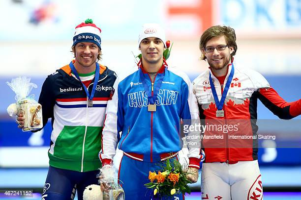 Gold medalist Ruslan Murashov of Russia Silver medalist Laurent Dubreuil of Canada and Bronze medalist Michel Mulder of the Netherlands pose for a...