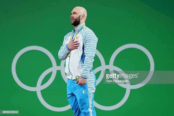 Gold medalist Ruslan Nurudinov of Uzbekistan celebrates on the podium during the medal ceremony during the Men's 105kg Group A Weightlifting contest...