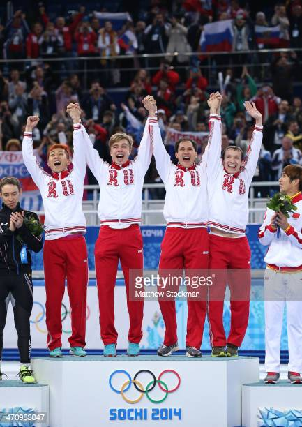 Gold medalist Russia celebrate during the flower ceremony for the Men's 5000m Relay on day fourteen of the 2014 Sochi Winter Olympics at Iceberg...