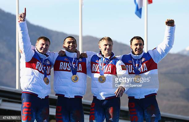 Gold medalist Russia team 1 celebrates on the podium during the medal ceremony for the Four-Man Bobsleigh on Day 16 of the Sochi 2014 Winter Olympics...