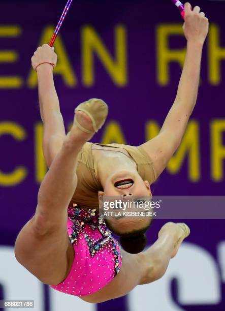 Gold medalist Russian team member Arina Averina performs with her clubs performs during the 33rd Rhythmic Gymnastics European championships in...