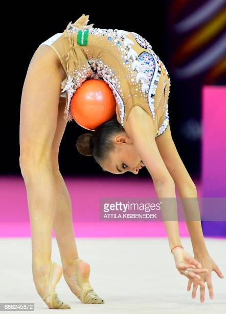 TOPSHOT Gold medalist Russia's Arina Averina performs with her ball in Papp Laszlo Arena of Budapest on May 21 2017 during the apparatus final day of...