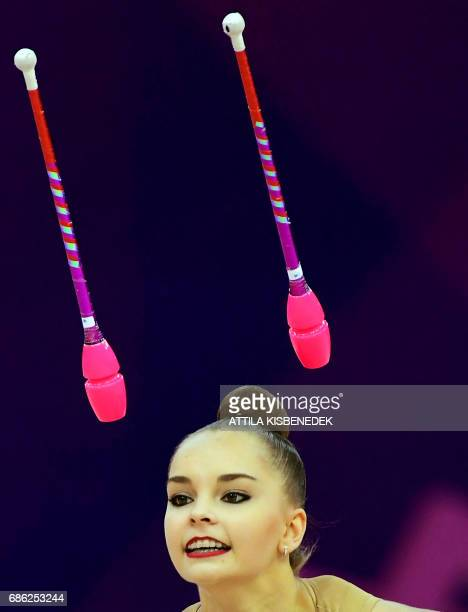 TOPSHOT Gold medalist Russia's Arina Averina performs with her clubs in Papp Laszlo Arena of Budapest on May 21 2017 during the apparatus final day...