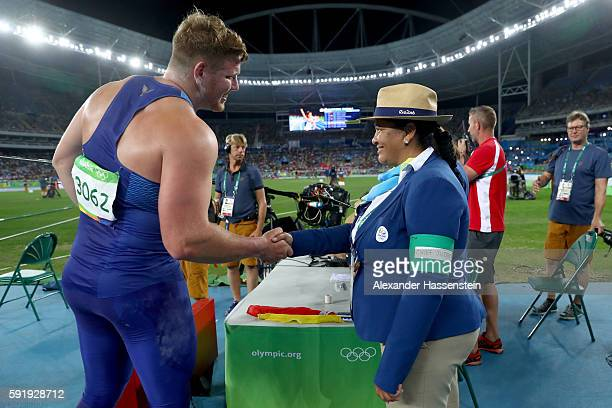 Gold medalist Ryan Crouser of the United States shakes hands with a judge during the Men's Shot Put Final on Day 13 of the Rio 2016 Olympic Games at...