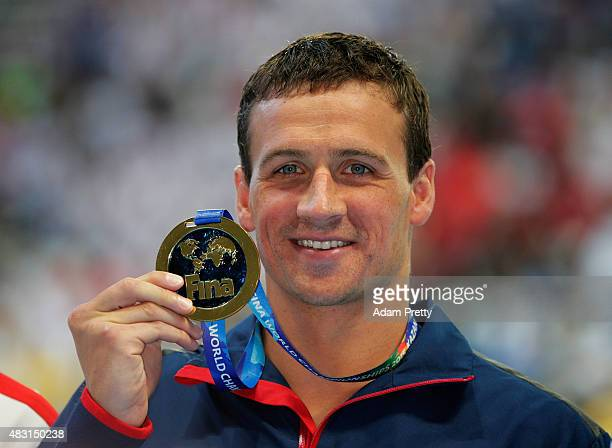 Gold medalist Ryan Lochte of the United States poses during the medal ceremony for the Men's 200m Individual Medley Final on day thirteen of the 16th...