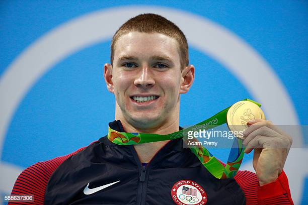 Gold medalist Ryan Murphy of the United States celebrates on the podium during the medal ceremony for the Men's 200m Backstroke Final on Day 6 of the...