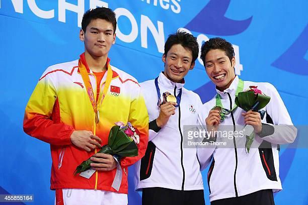 Gold medalist Ryosuke Irie of Japan Silver medalist Jiayu Xu of China and Bronze medalist Kosuke Hagino of Japan pose atop the podium after the Men's...