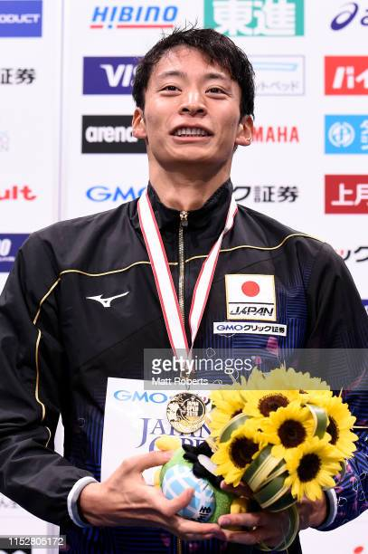 Gold medalist Ryosuke Irie of Japan smiles during the medal ceremony of the Men's 100m Backstroke Final on day two of the Swimming Japan Open at the...