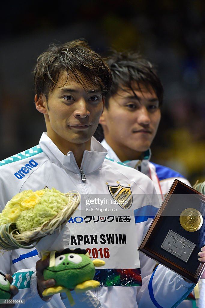Gold medalist Ryosuke Irie poses for photographs on the podium after the Men's 200m Backstroke final during the Japan Swim 2016 at Tokyo Tatsumi International Swimming Pool on April 9, 2016 in Tokyo, Japan.
