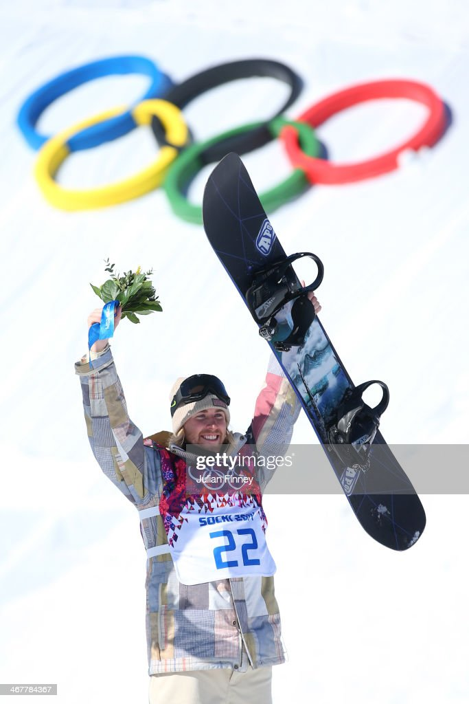 Gold medalist Sage Kotsenburg of the United States celebrates on the podium during the flower ceremony following the Snowboard Men's Slopestyle Final during day 1 of the Sochi 2014 Winter Olympics at Rosa Khutor Extreme Park on February 8, 2014 in Sochi, Russia.