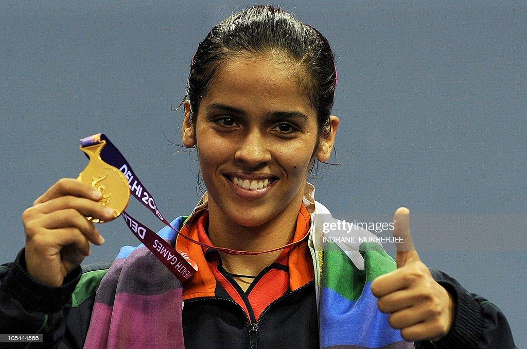 Gold medalist Saina Nehwal of India hold : News Photo