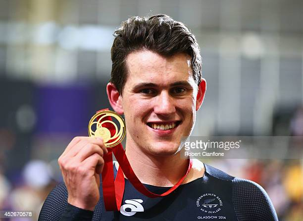 Gold medalist Sam Webster of New Zealand celebrates on the podium during medal ceremony for the Men's Sprint Final at Sir Chris Hoy Velodrome during...