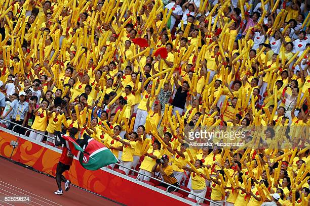 Gold medalist Sammy Wanjiru of Kenya celebrates after winning the Men's Marathon in the National Stadium during Day 16 of the Beijing 2008 Olympic...