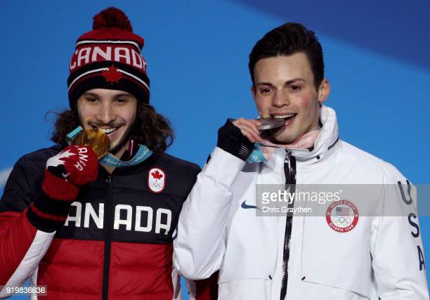 Gold medalist Samuel Girard of Canada and silver medalist JohnHenry Krueger of the United States celebrate during the medal ceremony for the Short...