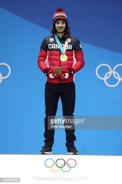 Gold medalist Samuel Girard of Canada celebrates during the medal ceremony for the Short Track Speed Skating Men's 1000m on nine one of the...