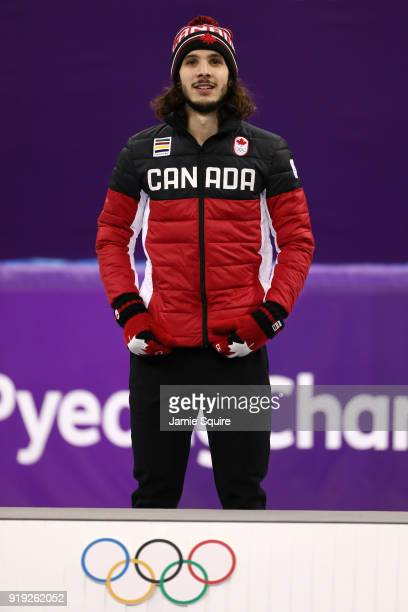 Gold medalist Samuel Girard of Canada celebrates during the victory ceremony after the Short Track Speed Skating Men's 1000m Final A on day eight of...