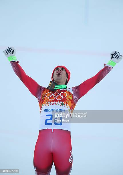 Gold medalist Sandro Viletta of Switzerland celebrates during the flower ceremony for the Alpine Skiing Men's Super Combined Downhill on day 7 of the...