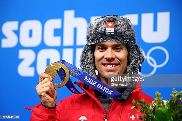 Gold medalist Sandro Viletta of Switzerland poses with his medal during the medal ceremony for the Alpine Skiing Men's Super Combined on day 8 of the...