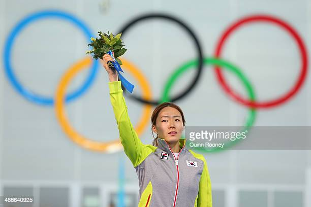 Gold medalist Sang Hwa Lee of South Korea celebrates on the podium during the flower ceremony for the Speed Skating Women's 500m Event during day 4...