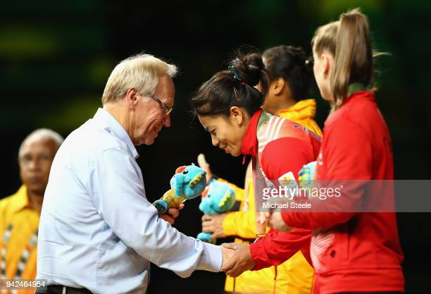 Gold medalist Sanjita Chanu Khumukcham of India is presented with her medal by Chairman of Gold Coast 2018 Commonwealth Games Corporation Peter...