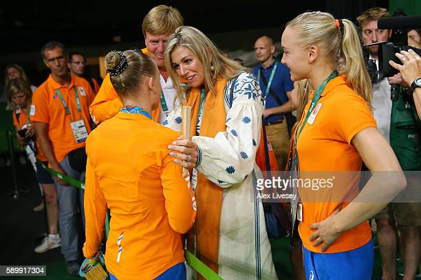 Gold medalist Sanne Wevers of the Netherlands is congratulated by Queen Maxima of the Netherlands while King WillemAlexander and their daughters look...