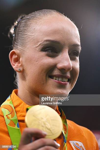 Gold medalist Sanne Wevers of the Netherlands poses for photographs after the at the medal ceremony for the Balance Beam on day 10 of the Rio 2016...