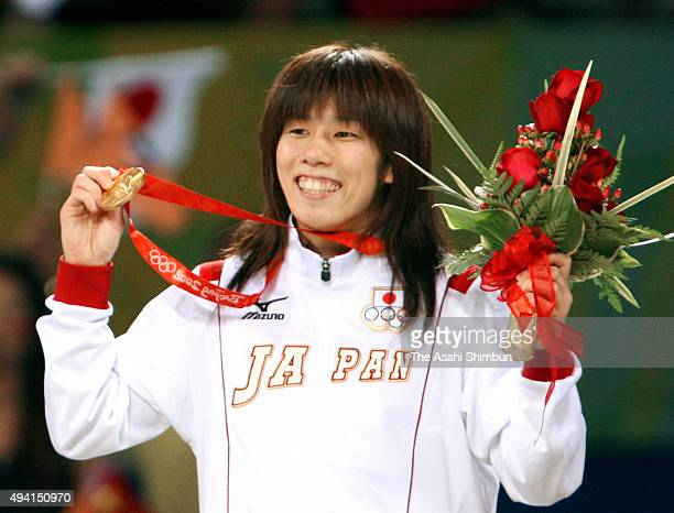 Gold medalist Saori Yoshida of Japan celebrates on the podium at the medal ceremony for the Wrestling women's -55kg at the China Agriculture...